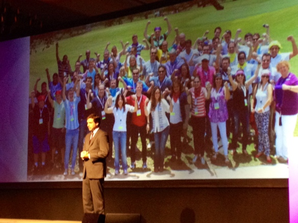 Kodak Alaris' Regional Business Manager for Latin America, Cassio Vaquero, updates partners about progress in 2013 and 2014.   Behind him is a photo of his very strong team.
