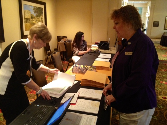 Kodak Alaris' Chief Event Officer, Megan Alekson (right), reviews logistics with a vendor while Kathy Raschiatore (seated) works on executive calendars.